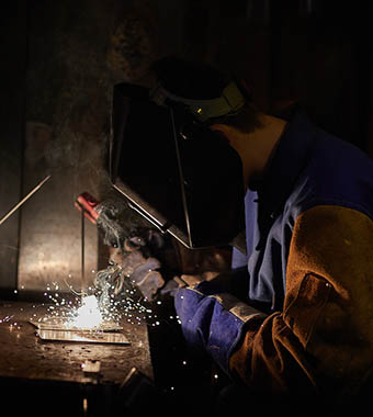 Columbus State student practicing welding techniques.