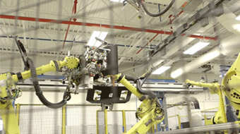 Honda factory robotic arms building car parts.