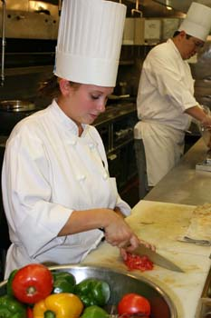 Student Chopping Tomatos