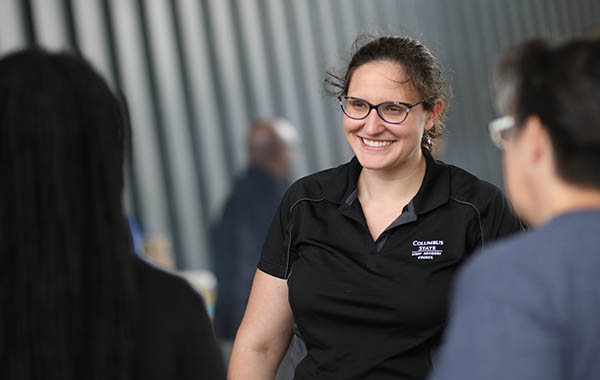 Photo of smiling female employee