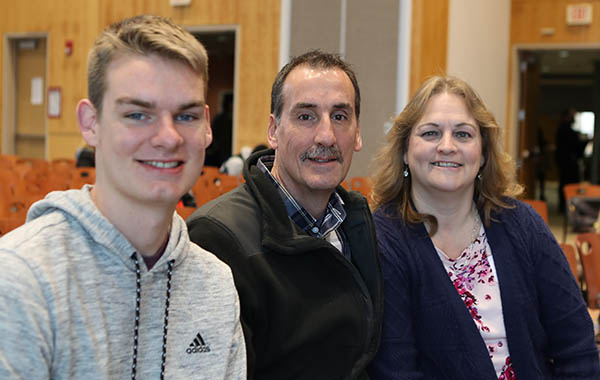 Photo of new student with parents