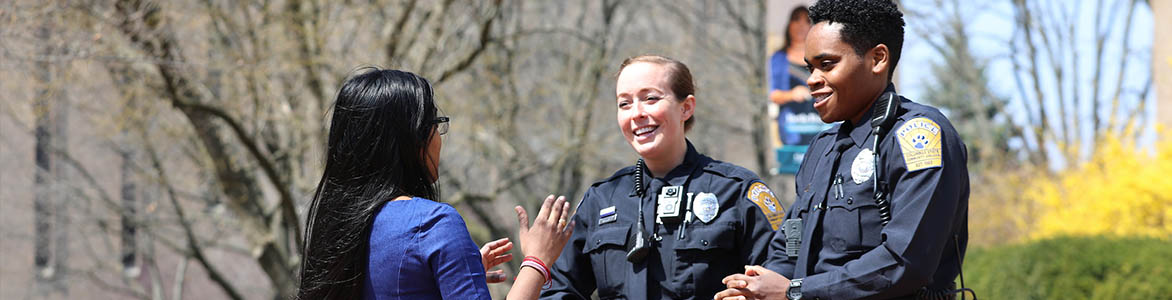 Officers talking to student